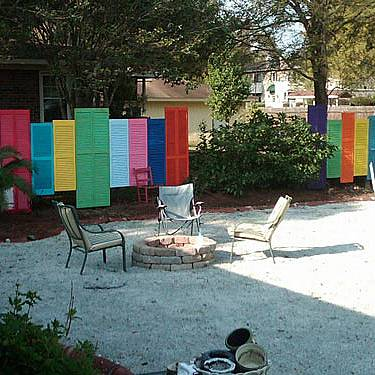 The old doors and windows with shutters painted in bright colors can become a pretty nice protection from curious eyes.