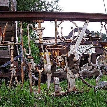 Stunning, but more difficult idea is to use instruments. Different machine parts and machine instruments can be welded to metal rails and between.