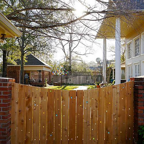 Colorful sunrays coming from the fence to the yard is one great spectacle. In ordinary wooden fence make small holes and put into them some colored glass or colored transparent foil.