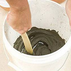 Mix two parts cement with one part water in a bucket.