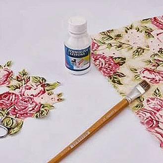 After that carefully glue them on the metal cans using the decoupage or PVA glue. The decoupage rule says that you have to apply the glue onto the napkin and then stick it on the surface from the center to the edges.