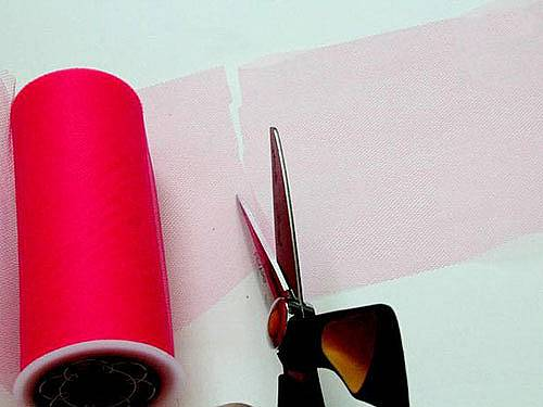 Cut the tulle on strips with width around 20 cm (you can also buy rolls with this width).
